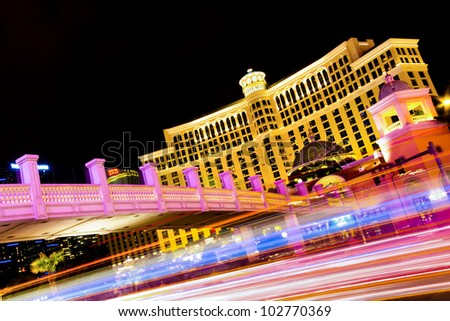 LAS VEGAS, NEVADA - MAY 7:  The Vegas Strip in Las Vegas, Nevada at night on May 7, 2012. The Strip is home to the largest hotels and casinos in the world such as the Bellagio seen here. - stock photo