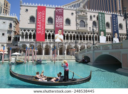 LAS VEGAS, NEVADA - MAY 9, 2014: Unidentified tourists enjoy gondola ride at Grand Canal at The Venetian Resort Hotel Casino. This luxury hotel opened in 1999 on Las Vegas Strip