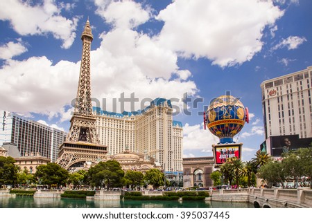 LAS VEGAS, NEVADA - MAY 7, 2014:  View of Las Vegas resorts, including Paris Las Vegas, Ballys and Planet Hollywood from across Bellagio Lagoon. - stock photo