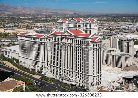 Las Vegas, Nevada - September 21, 2015: View of the Caesars Palace Hotel and Las Vegas Strip, internationally known for its concentration of resort hotels and casinos along its route. - stock photo