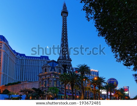 Las Vegas, Nevada, USA - April 5, 2013:  Morning picture of Las Vegas Strip in front  of the Paris Casino. Picture shows the Eiffel Tower  replica which is  about half the size of the original. - stock photo