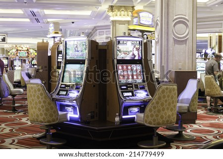 LAS VEGAS, NEVADA, USA - CIRCA JAN 2014: Slot machines in the Belaggio Hotel in Las Vegas. Bellagio is one of the most luxurious hotels in Las Vegas - stock photo