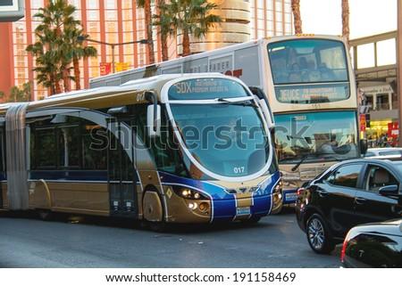 LAS VEGAS, NEVADA, USA - OCTOBER 25, 2013 : A regular and tourist buses in Las Vegas, Nevada. 40 million tourists visited Las Vegas in 2012  - stock photo