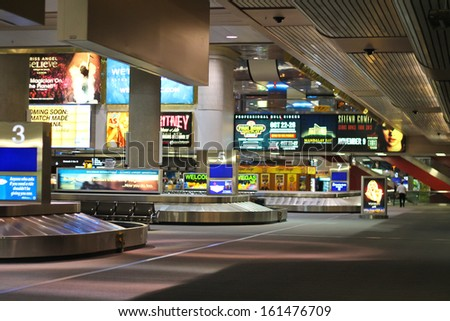 LAS VEGAS, NEVADA, USA - OCTOBER 20 : Arrival lounge in the airport McCarran on October 20, 2013 in Las Vegas, Nevada. Approximately 40 Million passengers pass through McCarren annually.  - stock photo