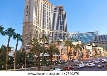 LAS VEGAS, NEVADA, USA - OCTOBER 21, 2013 :  Cars on the Strip  in Las Vegas, Nevada. 40 million tourists visited Las Vegas in 2012 - stock photo