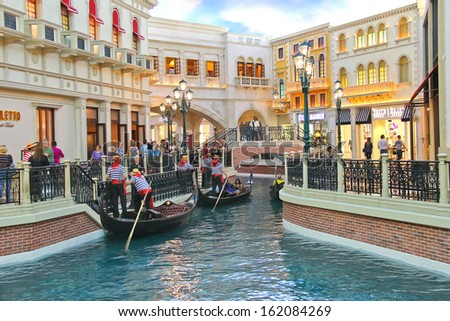 LAS VEGAS, NEVADA, USA - OCTOBER 20 : Gondola rides in Venetian  Hotel on October 20, 2013 in Las Vegas, The resort opened on May 3, 1999. One of the most luxurious hotels in Las Vegas