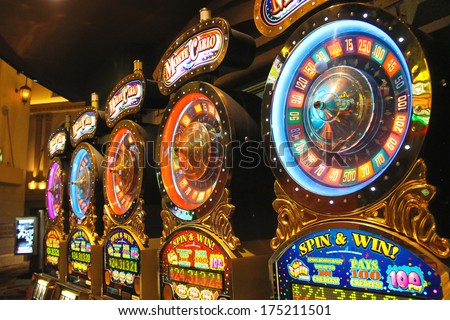 LAS VEGAS, NEVADA, USA - OCTOBER 21, 2013 : Slot machines in New York-New York Hotel and Casino in Las Vegas . The hotel opened in 1997. The interior is a copy of the streets of New York - stock photo