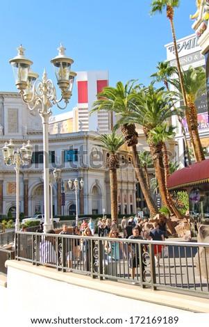 LAS VEGAS, NEVADA, USA - OCTOBER 20, 2013 : Tourists on the Strip  in Las Vegas, Nevada.  40 million tourists visited Las Vegas in 2012 - stock photo