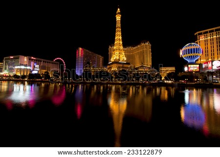 Las Vegas, Nevada, USA - Sept. 25, 2014: Nightlife along the famous Las Vegas Strip with Paris and Planet Hollywood Casinos reflecting in the Bellagio lake in Las Vegas, Nevada, USA - Sept. 25, 2014 - stock photo