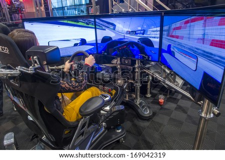 LAS VEGAS - NOV 05 : Race car Simulator at the SEMA Show in Las Vegas, Navada, on November 05, 2013. The SEMA Show is the premier automotive specialty products trade event in the world. - stock photo