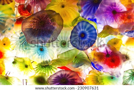 LAS VEGAS - NOV 8 : The Hand Blown Glass Flower Ceiling at the Bellagio Hotel on November 8, 2014 in Las Vegas. is comprised of 2,000 over glass blossoms by world-renowned glass sculptor Dale Chihuly. - stock photo