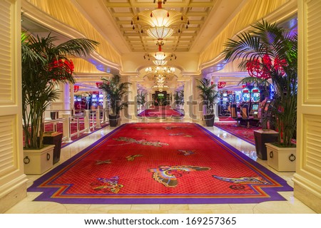 LAS VEGAS -NOV 24, 2013 : The interior of Wynn Hotel and casino on November 24, 2013 in Las Vegas. The hotel has 2,716 rooms and opened in 2005. - stock photo