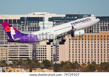 LAS VEGAS - NOVEMBER 11:A330 Hawaiian climbs after take off from McCarran in Las Vegas, USA on November 11, 2010. Hawaiian is the only airline based in hawaii serve international destinations