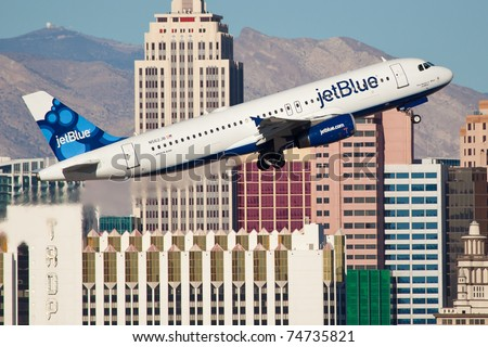 LAS VEGAS - NOVEMBER 12: A320 jetBlue Climbs after take off from McCarran Airport located in Las Vegas, USA on November 12, 2010. JetBlue is the fastest growing airline in the world as of 2011 - stock photo