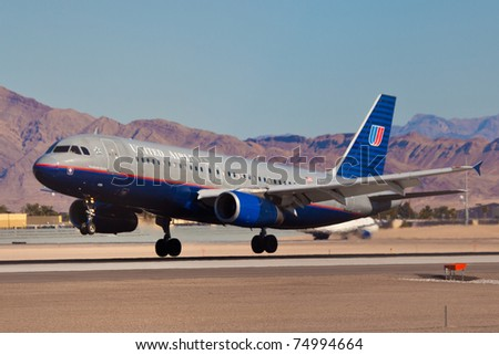 LAS VEGAS - NOVEMBER 12:A320 US Airways landing on McCarran in Las Vegas, USA on November 12, 2010. plane is wearing old style livery. US Airways is one of the oldest american airlines