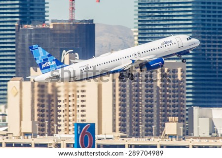 LAS VEGAS - NOVEMBER 7: Airbus A320 JetBlue departs from McCarran in Las Vegas, NV on November 7, 2014. A320 was the first narrow body airliner from Airbus and the biggest competition to Boeing 737. - stock photo