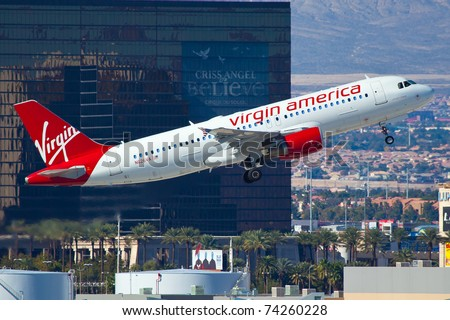 LAS VEGAS - NOVEMBER 12: Airbus A320 Virgin America climbs after take off from McCarran in Las Vegas, USA on November 12, 2010. A320 is the biggest rival for the most popular middle range plane B737 - stock photo