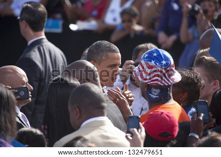 LAS VEGAS - NOVEMBER 01: Barack Obama among supporters at Presidential Campaign rally at Cheyenne Sports Complex on November 01, 2012 in North Las Vegas, Nevada - stock photo