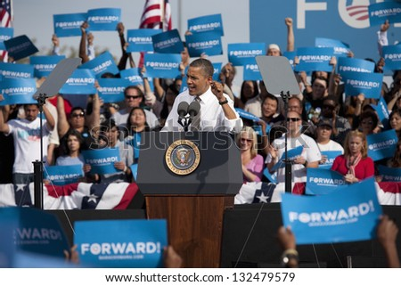 LAS VEGAS - NOVEMBER 01: Barack Obama speaks at a 2012 Election Campaign rally at Cheyenne Sports Complex on November 01, 2012 in North Las Vegas, Nevada - stock photo