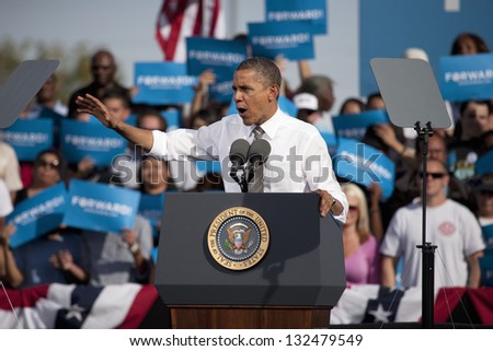 LAS VEGAS - NOVEMBER 01: Barack Obama speaks at Presidential Campaign rally at Cheyenne Sports Complex on November 01, 2012 in North Las Vegas, Nevada - stock photo