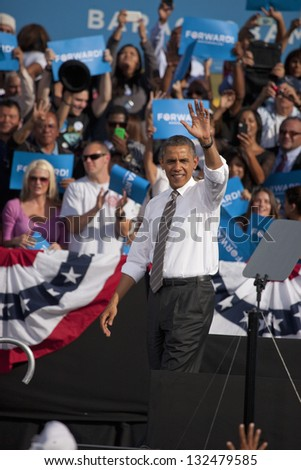 LAS VEGAS - NOVEMBER 01: Barack Obama waving to supporters at Presidential Campaign rally at Cheyenne Sports Complex on November 01, 2012 in North Las Vegas, Nevada - stock photo