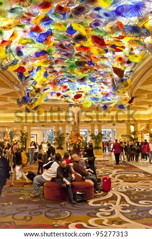 LAS VEGAS - NOVEMBER 20: Bellagio lobby with artwork on November 20, 2011 in Las Vegas. Chandelier called Fiori di Como is comprised of 2,000 hand-blown glass blossoms by glass sculptor Dale Chihuly. - stock photo