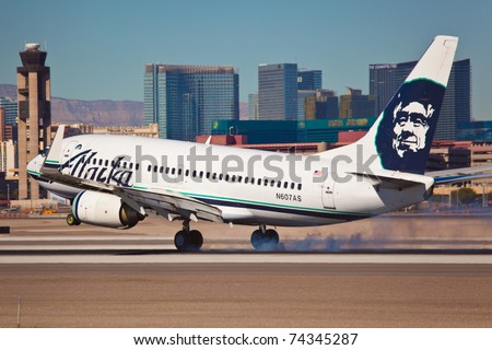 LAS VEGAS - NOVEMBER 15: Boeing 767 Alaska Airline touching down on McCarran in Las Vegas, USA on November 15, 2010. Alaska's route system spans more than 92 cities in United States, Canada, and Mexico