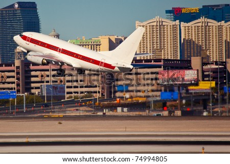 LAS VEGAS - NOVEMBER 12: Boeing 737-200 of Janet airline takes off from KLAS Airport in Las Vegas USA on November 12, 2010. Janet is a call sign used by planes transporting employees to famous AREA 51