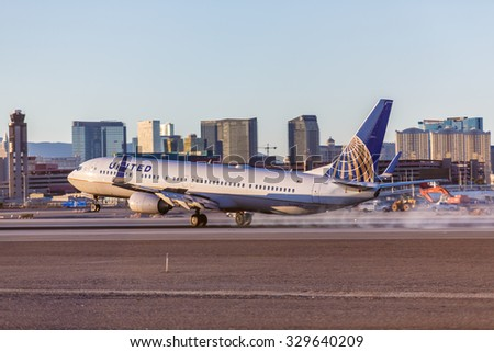 LAS VEGAS - NOVEMBER 3 Boeing 737 United Airlines lands at McCarran Airport in Las Vegas, NV on November 3, 2014. United is a major US airline. It has the worlds most rewarding loyalty program. - stock photo
