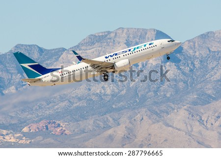 LAS VEGAS - NOVEMBER 3: Boeing 737 West Jet Airlines takes off from McCarran Airport in Las Vegas, NV on November 3, 2014. WestJet is a Canadian low-cost carrier and second-largest, behind Air Canada. - stock photo