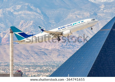 LAS VEGAS - NOVEMBER 3: Boeing 737 West Jet Airlines takes off from McCarran Airport in Las Vegas, NV on November 3, 2014. WestJet is a Canadian low-cost carrier and second-largest, behind Air Canada.
