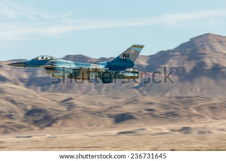LAS VEGAS -NOVEMBER 8: F-16 Falcon performs air show routine during Aviation Nation at Nellis AFB on November 8,2014 in Las Vegas,NV. F-16 is the most popular supersonic fighter jet in the world.