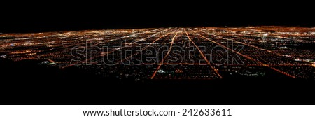 LAS VEGAS - NOVEMBER 26, 2011: Panoramic view of famous Las Vegas seen from elevation at night.  The Strip is world famous for its extravagant hotel casinos. - stock photo