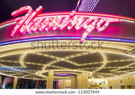 LAS VEGAS - NOVEMBER 08: The Flamingo hotel and casino sign on November 08, 2012 in Las Vegas. Las Vegas in 2012 is projected to break the all-time visitor volume record of 39-plus million visitors - stock photo