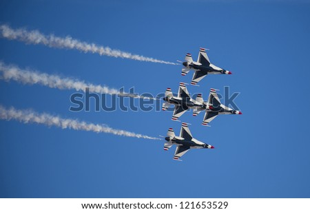 LAS VEGAS - NOVEMBER 11: Thunderbird F-16 Aircrafts performing in an air show on November 11, 2012 in Las Vegas,USA. The Thunderbirds are the air demonstration squadron of the United States Air Force