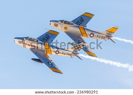 LAS VEGAS -NOVEMBER 8: Two P-51 Mustangs perform during Aviation Nation at Nellis AFB on November 8,2014 in Las Vegas,NV. P-51 was an American fighter used during World War II and other conflicts. - stock photo