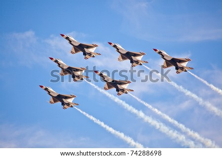 LAS VEGAS -NOVEMBER 13: USAF Thunderbirds formation diamond using the newest version of th f-16 block 52 during Aviation Nation at Nellis Air Force Base on November 13, 2010 in Las Vegas, NV - stock photo