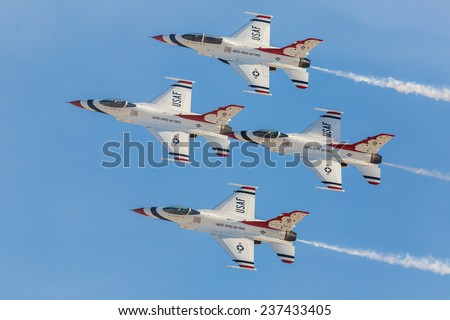 LAS VEGAS -NOVEMBER 8: USAF Thunderbirds perform air show routine during Aviation Nation at Nellis AFB on November 8,2014 in Las Vegas,NV. Squadron is the official air demonstration team for the USAF.