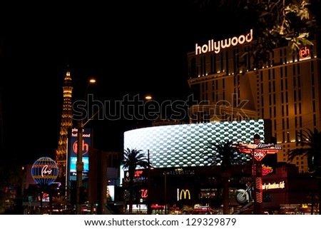 LAS VEGAS, NV - FEBRUARY 17:  Paris Las Vegas and Planet Hollywood hotels & casinos at night just days before a fatal shoot-out on the strip, Las Vegas, NV - February 17, 2013 - stock photo