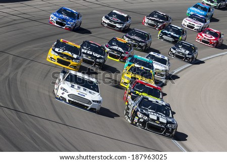 Las Vegas , NV - Mar 09, 2014:  Brad Keselowski (2) and Jimmie Johnson (48) battle for position during the Kobalt Tools 400 race at the Las Vegas Motor Speedway  in Las Vegas , NV. - stock photo