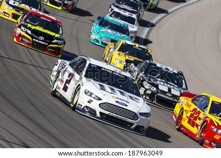 Las Vegas , NV - Mar 09, 2014:  Brad Keselowski (2) battles for position during the Kobalt Tools 400 race at the Las Vegas Motor Speedway  in Las Vegas , NV. - stock photo