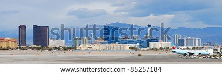 LAS VEGAS, NV - MAR 4: McCarran Airport and Vegas skyline on March 4, 2010 in Las Vegas, Nevada. McCarran ranked 15th in the world for passenger traffic in 2008 due to the fabulous Vegas attractions. - stock photo