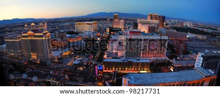 LAS VEGAS, NV - MAR 4: Vegas Strip aerial view at dusk on March 4, 2010 in Las Vegas, Nevada. The Las Vegas Strip is 3.8 mile stretch featured with world class hotels and casino. - stock photo