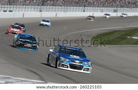 LAS VEGAS, NV - March 08: Dale Earnhardt Jr leading a pack of cars at the NASCAR Sprint Kobalt 400 race at Las Vegas Motor Speedway on March 08, 2015 - stock photo