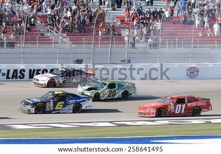 LAS VEGAS, NV - March 07: Erik Jones wrecks his car (20) at the NASCAR Boyd Gaming 300 Xfinity race at Las Vegas Motor Speedway in Las Vegas, NV on March 07, 2015 - stock photo