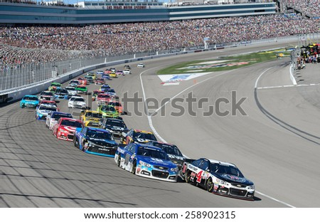 LAS VEGAS, NV - March 08: Kevin Harvick leads at the NASCAR Sprint Kobalt 400 race at Las Vegas Motor Speedway on March 08, 2015 - stock photo