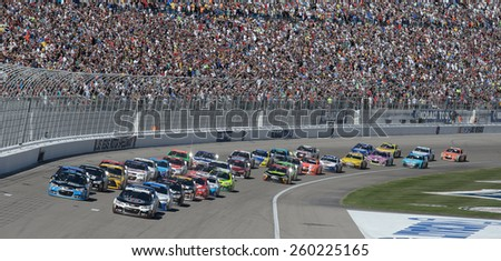 LAS VEGAS, NV - March 08: Kevin Harvick (4) leads the field at the restart at the NASCAR Sprint Kobalt 400 race at Las Vegas Motor Speedway on March 08, 2015 - stock photo