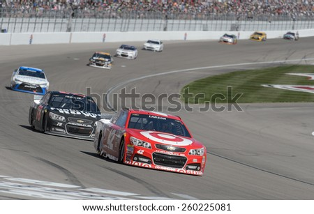 LAS VEGAS, NV - March 08: Kyle Larson (42) leading a pack of cars at the NASCAR Sprint Kobalt 400 race at Las Vegas Motor Speedway on March 08, 2015 - stock photo