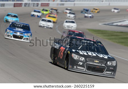 LAS VEGAS, NV - March 08: Martin Truex Jr (78) leading a pack of cars at the NASCAR Sprint Kobalt 400 race at Las Vegas Motor Speedway on March 08, 2015 - stock photo