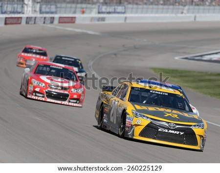 LAS VEGAS, NV - March 08: Matt Kenseth (20) leading a pack of cars at the NASCAR Sprint Kobalt 400 race at Las Vegas Motor Speedway on March 08, 2015 - stock photo